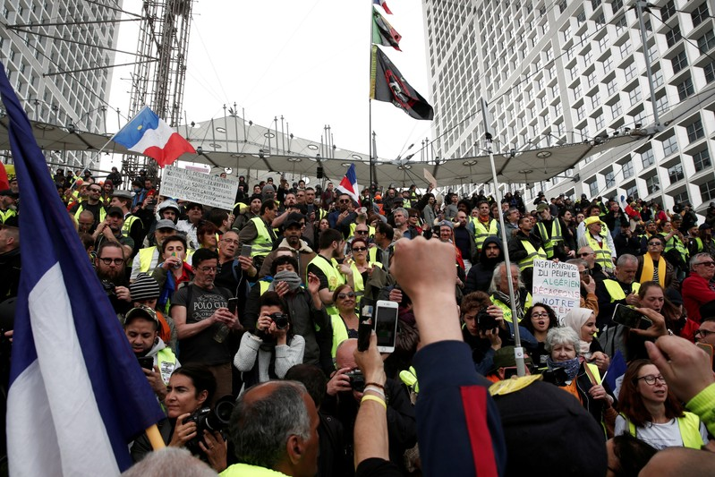 FILE PHOTO: Protesters wearing yellow vests attend a demonstration during the Act XXI (the 21st consecutive national protest on Saturday) of the yellow vests movement at the financial district of La Defense near Paris