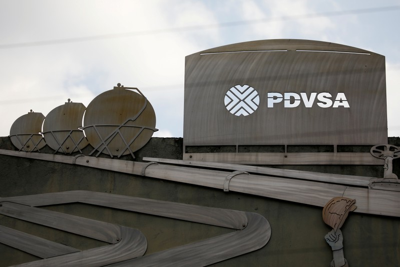 FILE PHOTO: FILE PHOTO: Cutouts depicting images of oil operations are seen outside a building of Venezuela's state oil company PDVSA in Caracas