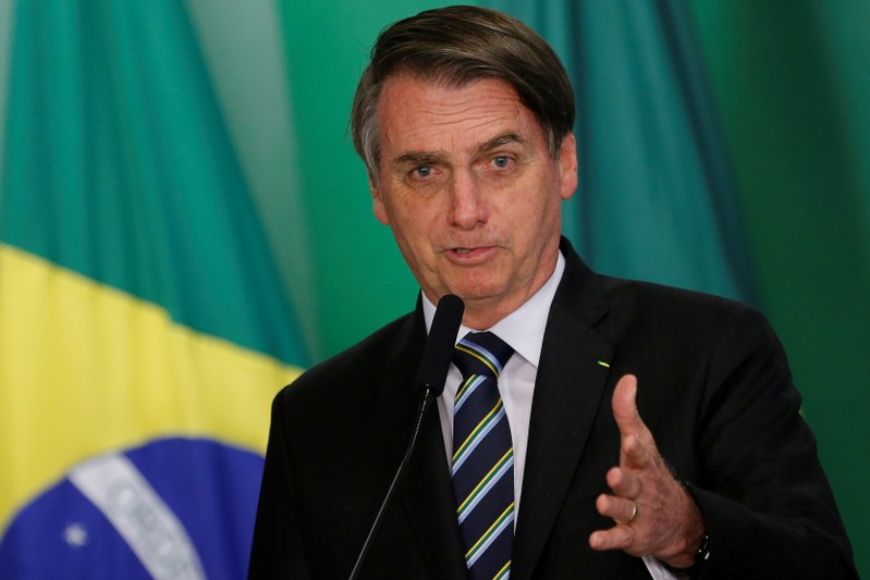 FILE PHOTO: Brazil's President Jair Bolsonaro speaks during inauguration ceremony of the new Education Minister Abraham Weintraub at the Planalto Palace in Brasilia
