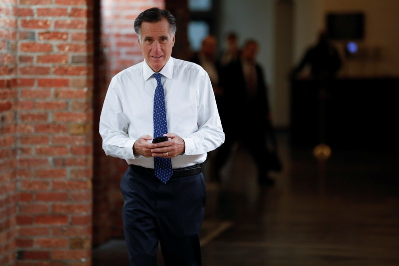 FILE PHOTO: Sen. Mitt Romney (R-UT) walks to his office on the opening day of the 116th Congress on Capitol Hill in Washington