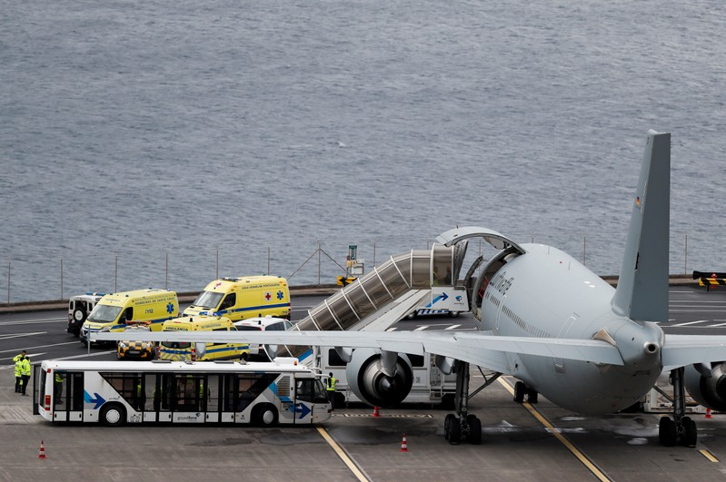 Ambulances transporting injured German tourists involved in a bus accident, arrive at a German Air Force medical airplane at Cristiano Ronaldo Airport in Funchal, on the island of Madeira