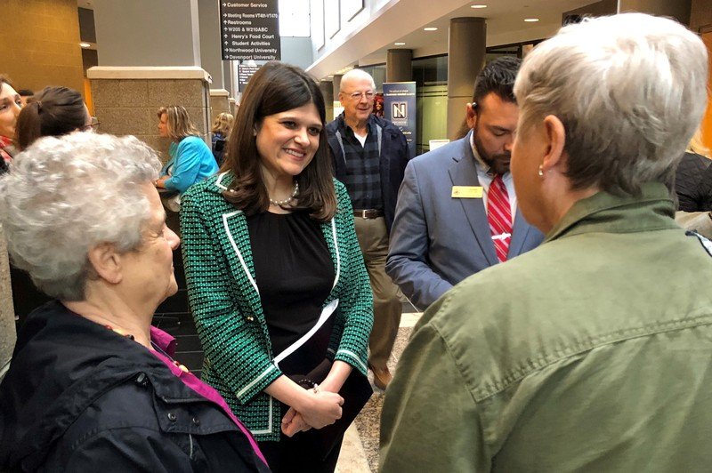 FILE PHOTO - U.S. Representative Haley Stevens speaks with constituents at a town hall meeting in Livonia