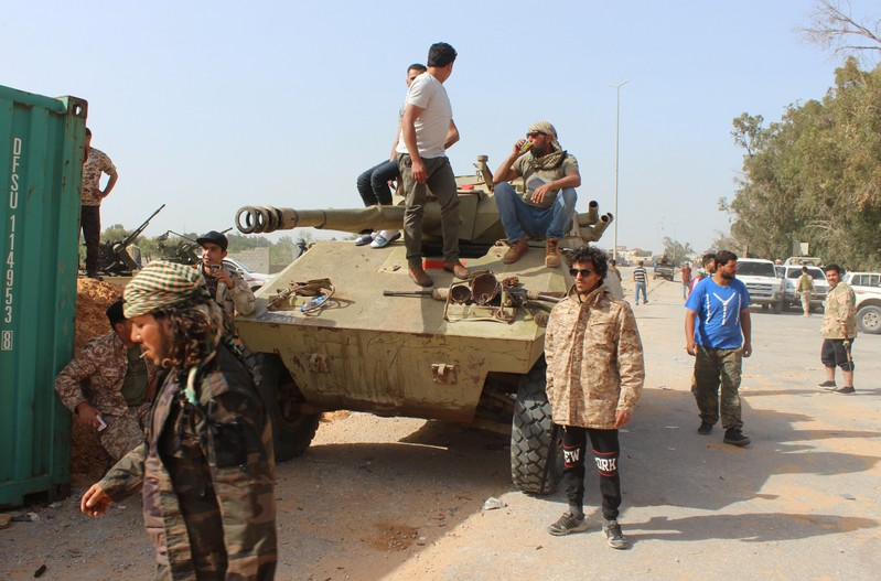 Members of the Libyan internationally recognised government forces gather around APC at Khallat Farjan area in Tripoli