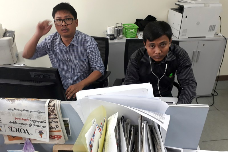 FILE PHOTO - Reuters journalists Wa Lone and Kyaw Soe Oo pose for a picture at the Reuters office in Yangon, Myanmar