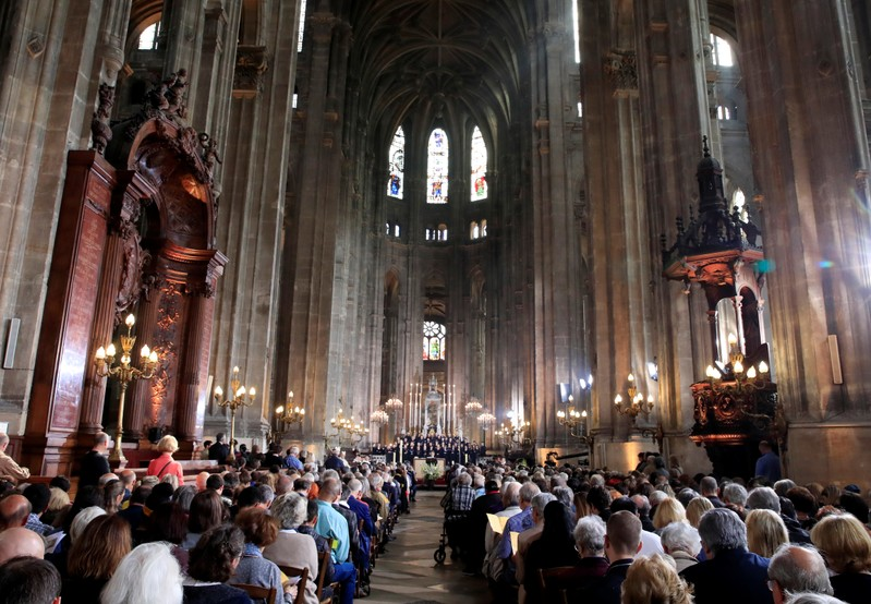 People attend Easter Sunday Mass at Saint-Eustache, days after a massive fire devastated large parts of the structure of the gothic Notre-Dame Cathedral, in Paris