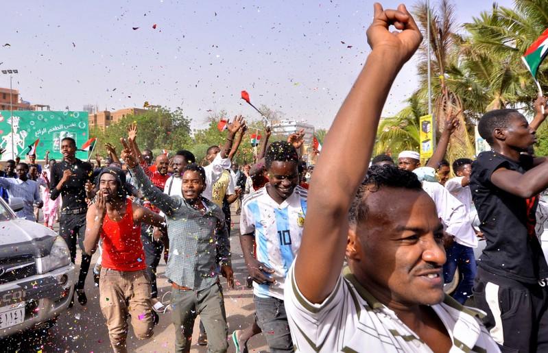 FILE PHOTO - Sudanese demonstrators chant slogans along the streets in Khartoum