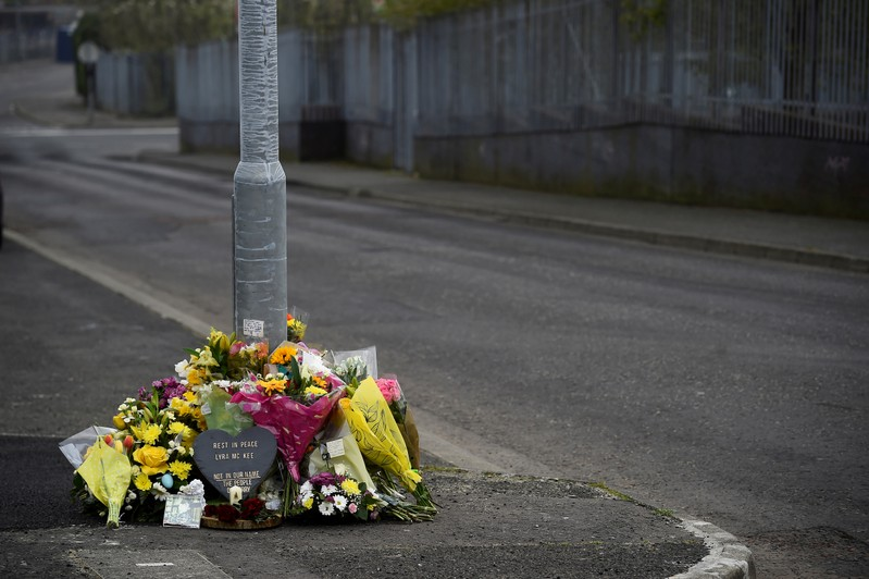 Flowers and a candle are left at the exact spot where 29-year-old journalist Lyra McKee was shot dead, in Londonderry