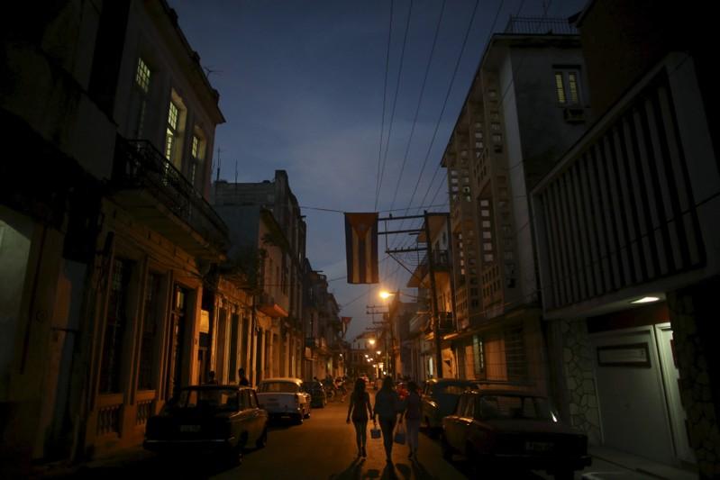 People walk on a street in downtown Havana