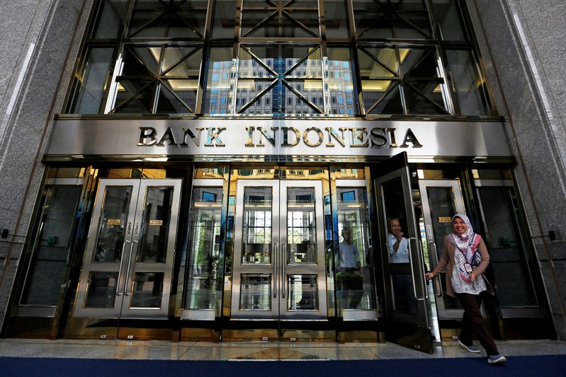 FILE PHOTO: Visitors leave Bank Indonesia headquarters in Jakarta, Indonesia