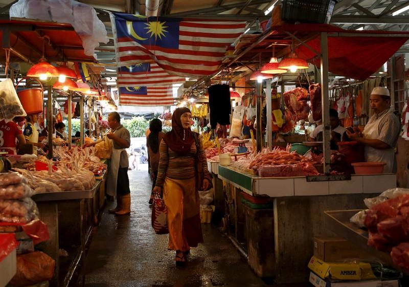 FILE PHOTO: A woman shops in a wet market in Kuala Lumpur