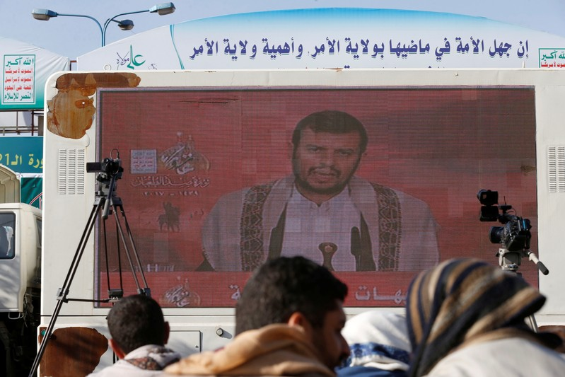 Leader of the Shi'ite Houthi movement, Abdul-Malik Badruddin al-Houthi, addresses supporters via a screen during a demonstration to mark the Ashura holy day in Sanaa