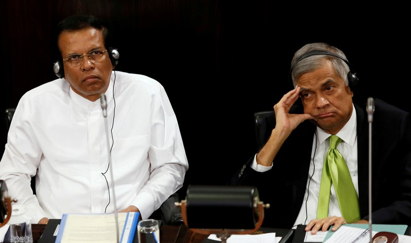 FILE PHOTO: Sri Lanka's President Maithripala Sirisena and Prime Minister Ranil Wickremesinghe look on during a Parliament session marking the 70th anniversary of Sri LankaÕs Government, in Colombo