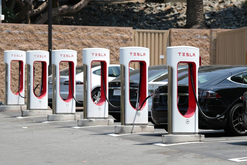 FILE PHOTO: A Tesla electric car supercharger station is seen in Los Angeles