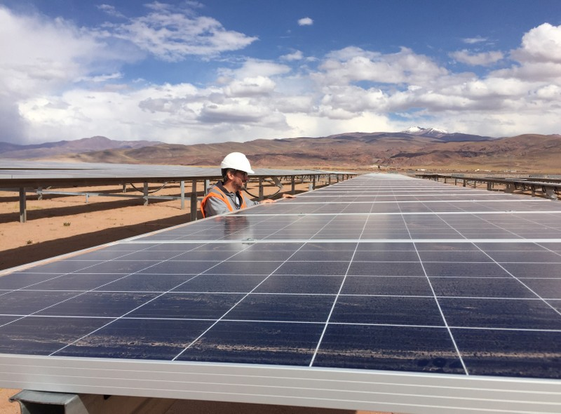 Guillermo Giralt, technical director of Cauchari Solar, stands next to solar panels at a solar farm, built on the back of funding and technology from China, in Salar de Cauchari
