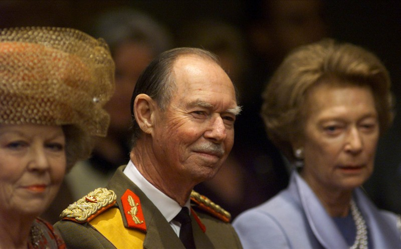 FILE PHOTO: Dutch Queen Beatrix (L), Grand Duke Jean (C) and his wife Josephine Charlotte (R) assist the swearing-in of Grand Duke Henri in Luxembourg