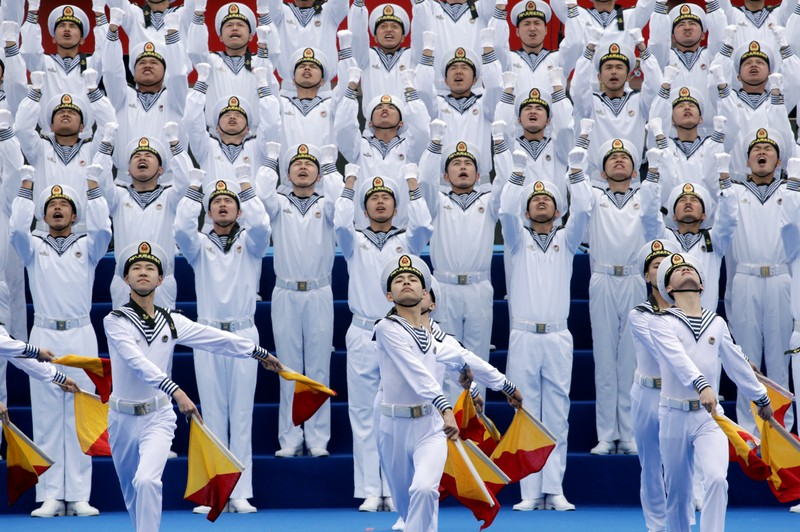 Chinese navy personnel perform at an event celebrating the 70th anniversary of the founding of the Chinese People's Liberation Army Navy (PLAN) in Qingdao