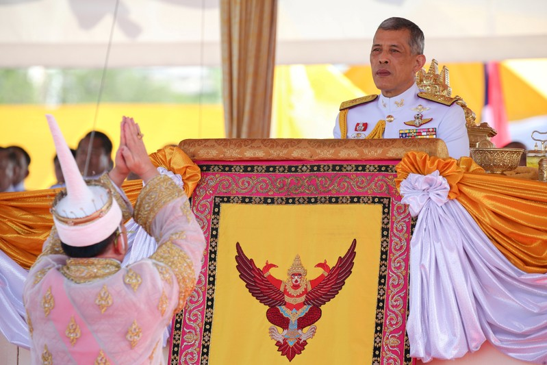 Lertviroj Kowattana, permanent secretary of the Thai Ministry of Agriculture and Cooperatives, dressed in a traditional costume, greets Thailand's King Maha Vajiralongkorn during the annual Royal Ploughing Ceremony in central Bangkok