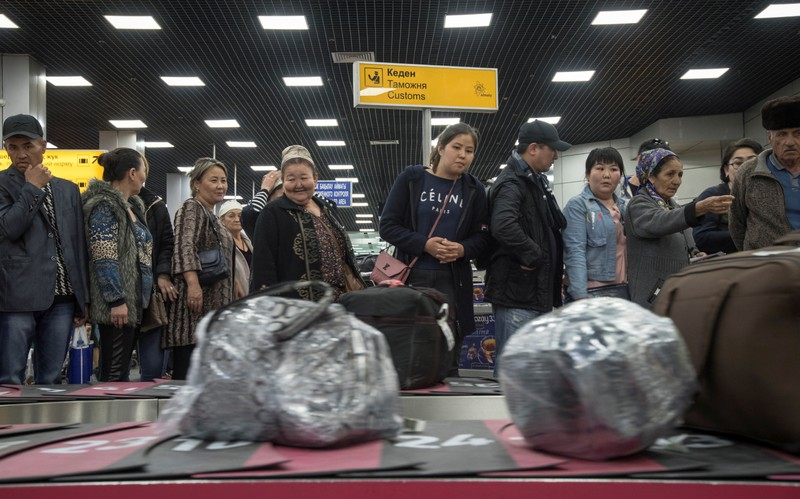 Passengers of a flight from Ashgabat gather at Almaty International Airport