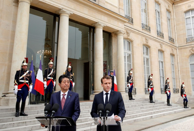 French President Emmanuel Macron and Japan's Prime Minister Shinzo Abe give a joint statement to the media at the Elysee Palace in Paris