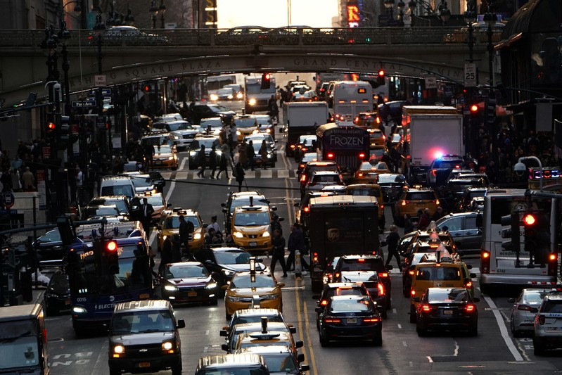 FILE PHOTO: Traffic is pictured at twilight along 42nd St. in Manhattan