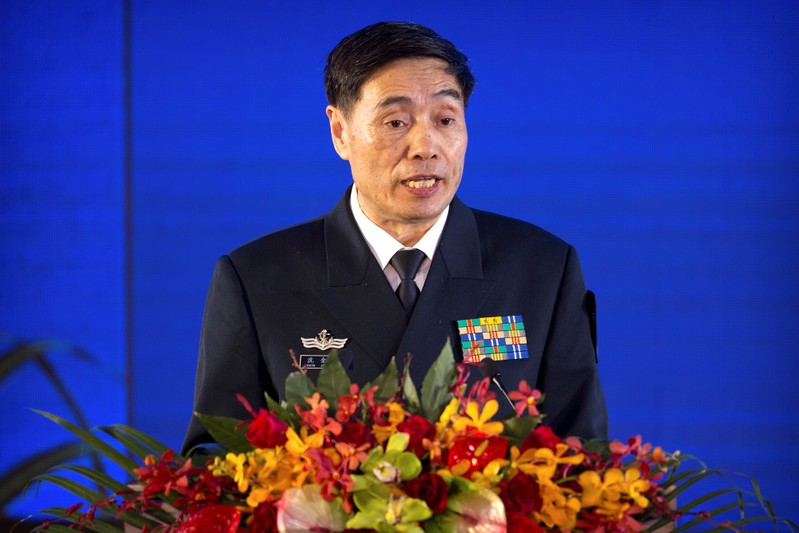 Vice Admiral Shen Jinlong, commander of the Chinese People's Liberation Army (PLA) Navy, speaks at a welcome reception for the commemoration of the 70th anniversary of the founding of the China's navy in Qingdao