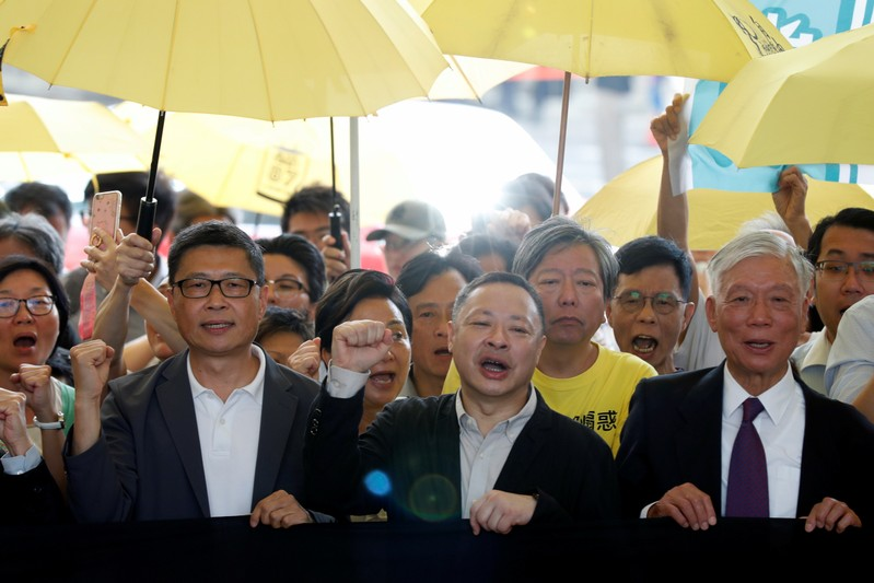 Pro-democracy activists arrive at the court for sentencing on their involvement in the Occupy Central, in Hong Kong