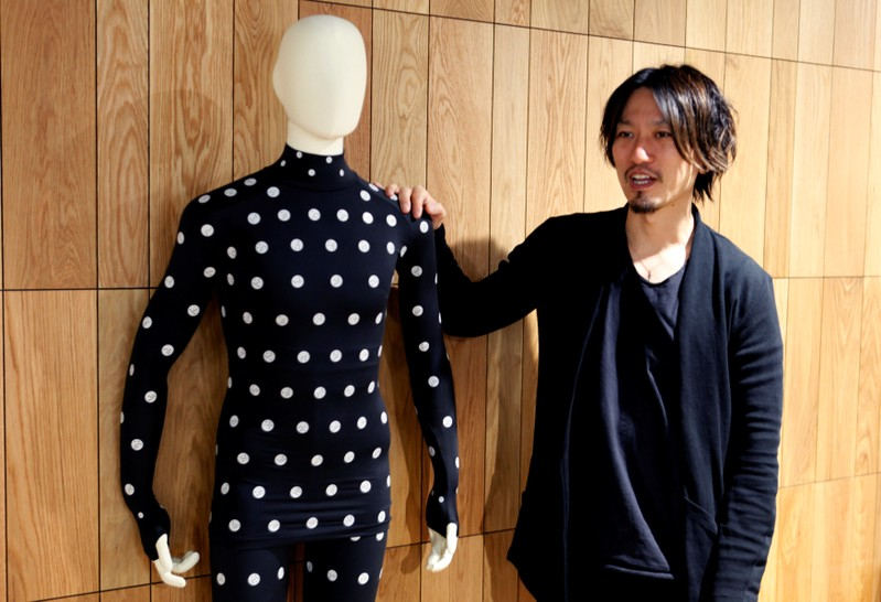 Yuki Kanayama, Chief Innovation Officer of Zozo Technologies, poses with a Zozosuit after an interview with Reuters in Tokyo