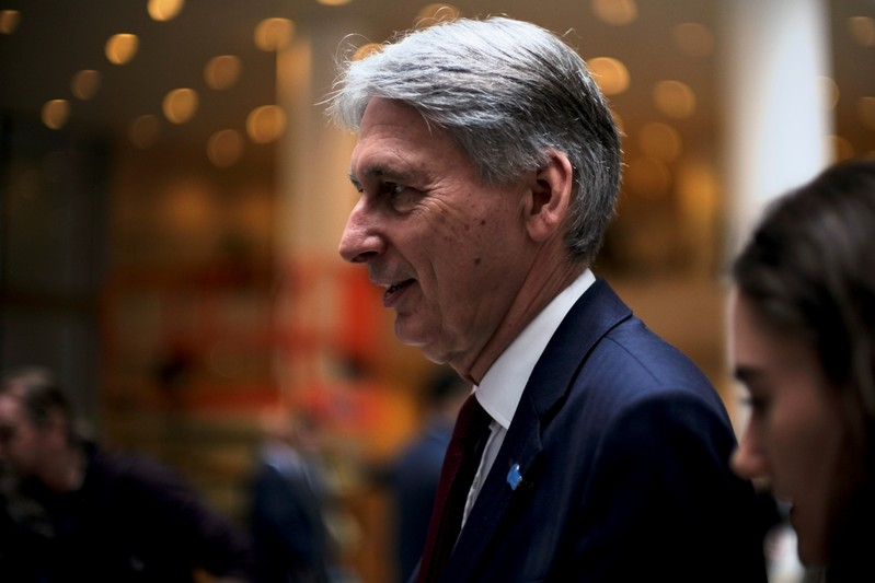 FILE PHOTO: Chancellor of the Exchequer Philip Hammond attends the IMF and World Bank's 2019 Annual Spring Meetings, in Washington