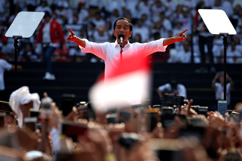 FILE PHOTO: Indonesia's incumbent presidential candidate Joko Widodo gestures as he speaks during a campaign rally at Gelora Bung Karno stadium in Jakarta