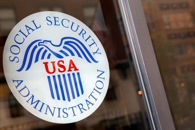 FILE PHOTO: Sign is seen on the entrance to a Social Security office in New York