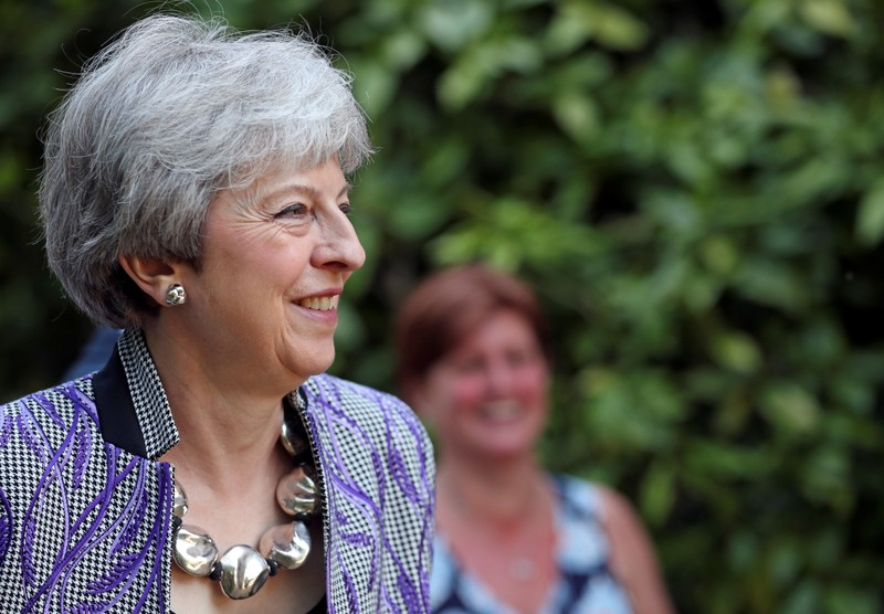 Britain's Prime Minister Theresa May leaves church in Sonning