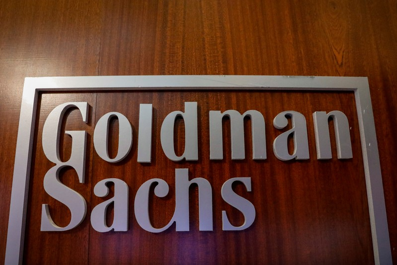 FILE PHOTO - The Goldman Sachs company logo is seen in the company's space on the floor of the NYSE in New York
