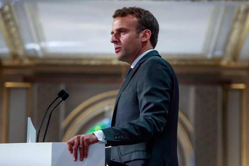 French President Emmanuel Macron delivers a speech for the Parisian Firefighters' brigade and security forces who took part at the fire extinguishing operations during the Notre Dame of Paris Cathedral fire, at Elysee Palace