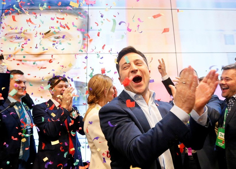 FILE PHOTO: Candidate Zelenskiy reacts following the announcement of an exit poll in a presidential election in Kiev
