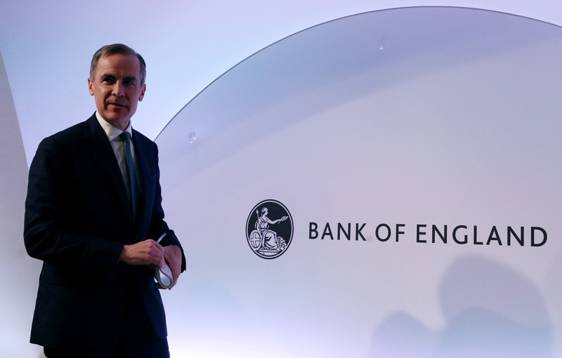 FILE PHOTO: The Governor of the Bank of England, Mark Carney leaves after a news conference at the Bank of England in London