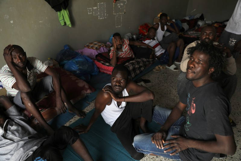 Migrants are seen at the Anti-Illegal Immigration Agency in Tajora shelter center in Tripoli