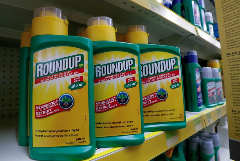 FILE PHOTO: Bayer's Roundup weed killer atomizers are displayed for sale at a garden shop near Brussels