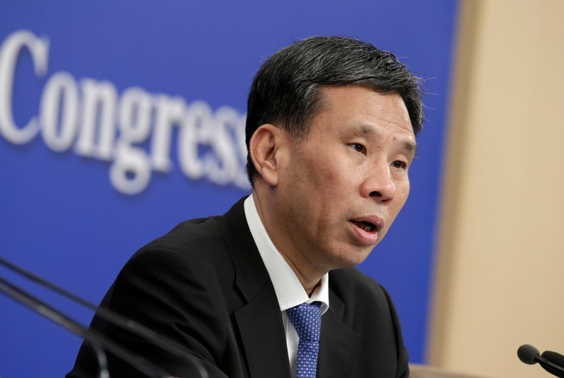 Chinese Finance Minister Liu Kun attends a news conference during the ongoing NPC in Beijing