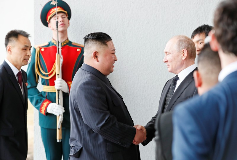 Russia's President Vladimir Putin shakes hands with North Korea leader Kim Jong Un at the Far Eastern Federal University campus at Russky Island in the far eastern city of Vladivostok, Russia