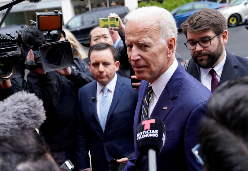 FILE PHOTO: Former Vice President Biden speaks to reporters after speaking at electrical workers' conference in Washington