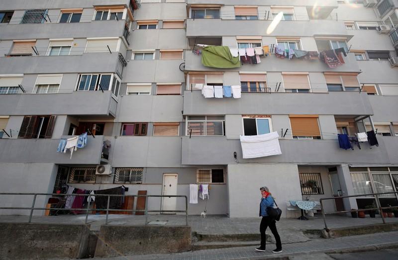 A woman walks by Ciudad Meridiana neighbourhood in Barcelona