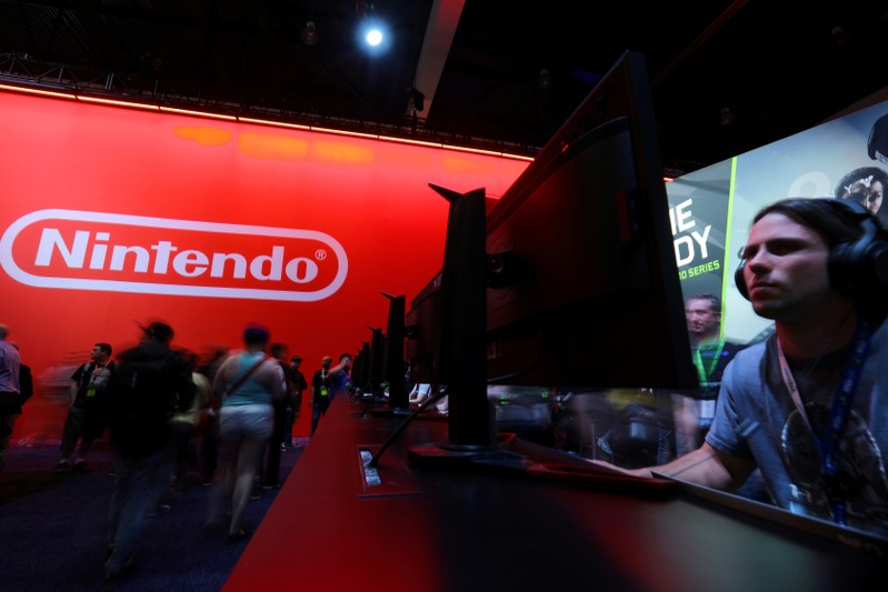 FILE PHOTO: Attendee plays a video game at the E3 2017 Electronic Entertainment Expo in Los Angeles