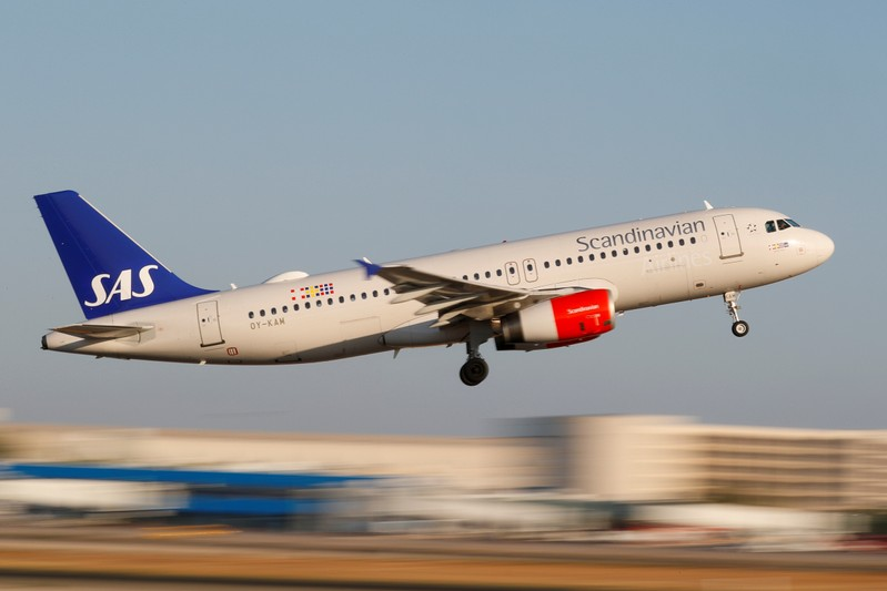 FILE PHOTO: A SAS Airbus A320 airplane takes off from the airport in Palma de Mallorca