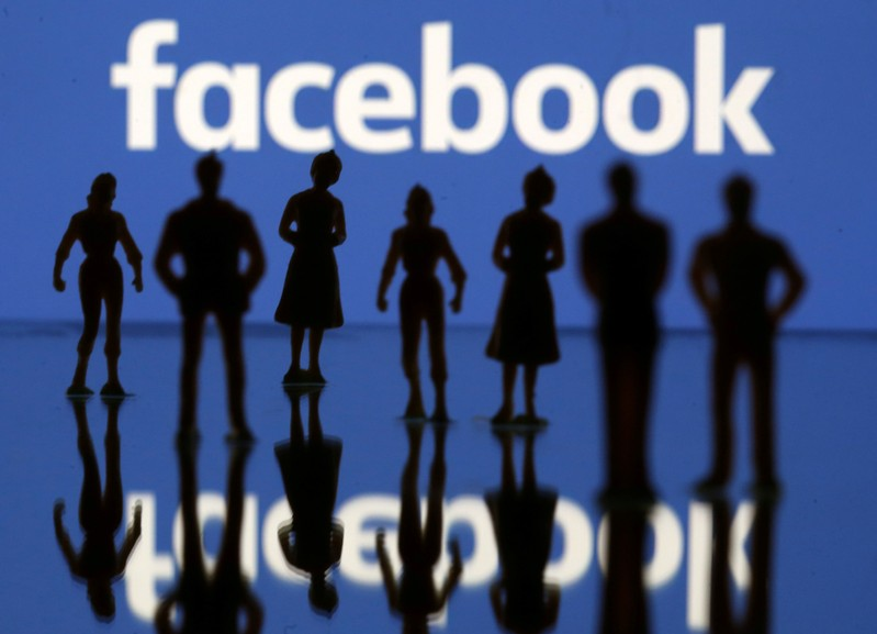 FILE PHOTO: Small toy figures are seen in front of Facebook logo in this illustration picture