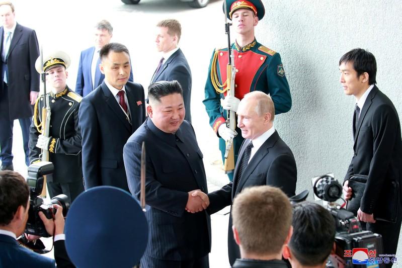 North Korean leader Kim Jong Un shakes hands with Russian President Vladimir Putin in Vladivostok