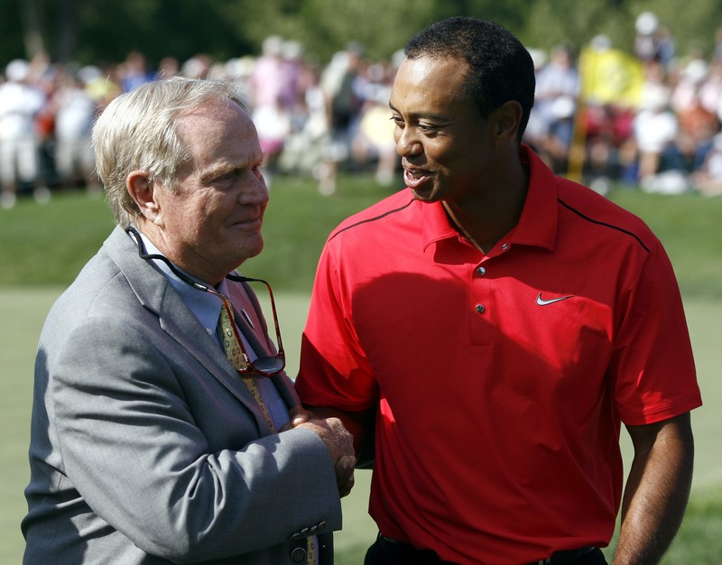 FILE PHOTO: Tiger Woods of the U.S. is congratulated by Jack Nicklaus after his final round of the Memorial Tournament at Muirfield Village Golf Club in Dublin