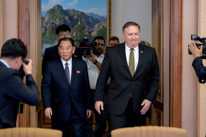 FILE PHOTO: U.S. Secretary of State Mike Pompeo and Kim Yong Chol, a North Korean senior ruling party official and former intelligence chief, return to discussions after a break at Park Hwa Guest House in Pyongyang