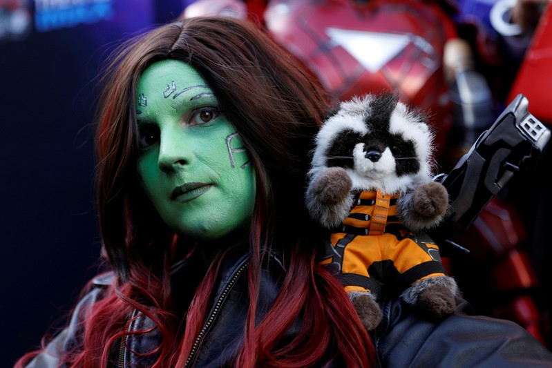 An Avengers fan poses as she arrives dressed as Gamora at the TCL Chinese Theatre in Hollywood to attend the opening screening of