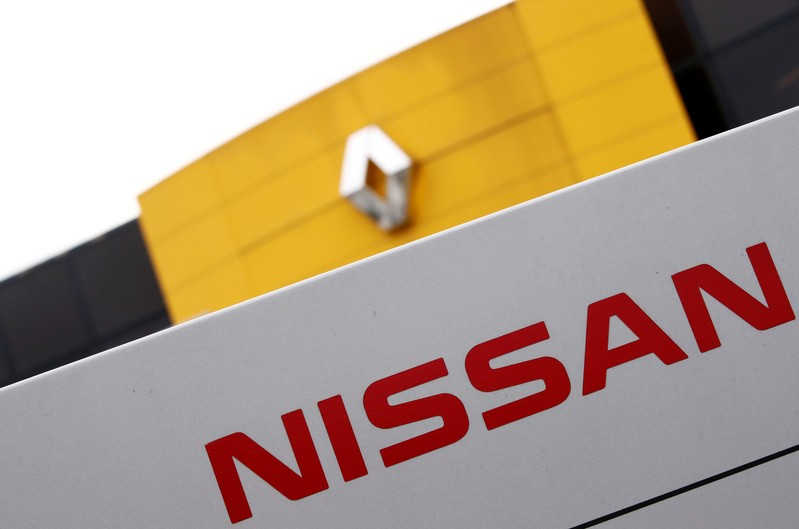 FILE PHOTO: The logos of car manufacturers Renault and Nissan are seen in front of a common dealership of the companies in Saint-Avold