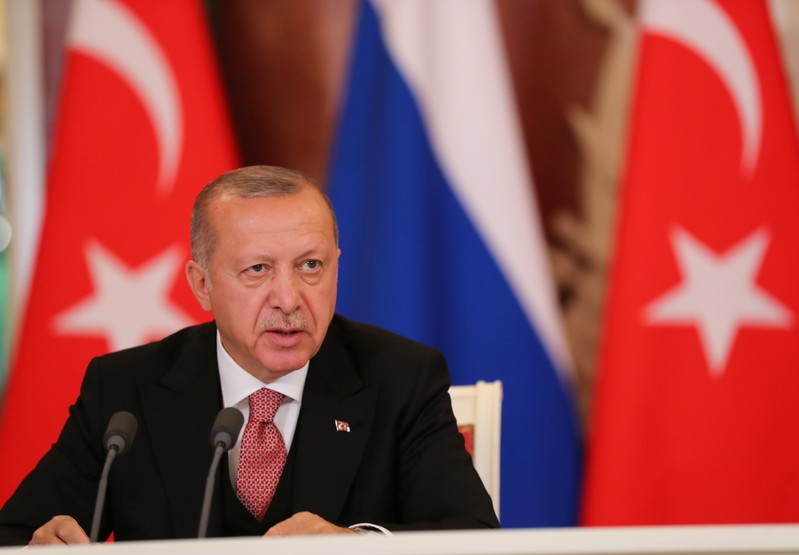 FILE PHOTO - Turkish President Erdogan speaks during a news conference in Moscow